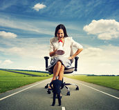 Woman and small man on the road Royalty Free Stock Images