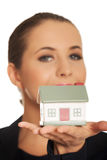 Woman with small model house on hand Stock Photography