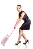 Woman and small pink luggage Stock Images