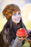 Woman with small pumpkin Royalty Free Stock Photos