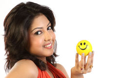 Woman with small yellow ball Stock Photos