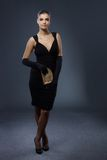 Woman in smart black evening dress Royalty Free Stock Images