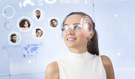 Woman with smart glasses. Young women in smart glasses with virtual screen Royalty Free Stock Images