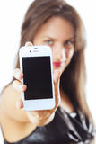 Woman with smart phone. Young woman holding smart phone Royalty Free Stock Image