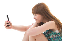 Woman and smart phone. Young woman to see a smart phone Royalty Free Stock Images