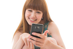 Woman and smart phone. Young woman to see a smart phone Royalty Free Stock Image