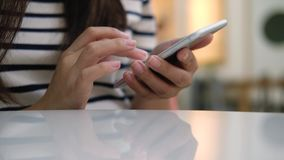 Woman and smart phone stock footage