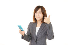 Woman with a smart phone  Stock Photos
