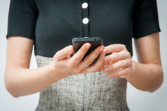 Woman with smart phone Royalty Free Stock Photo