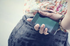 Woman with smart phone Stock Images