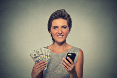 Woman with smart phone and dollar banknotes stock photos
