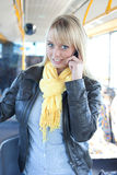 Woman with a smart-phone inside a bus Royalty Free Stock Photo