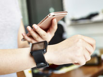 Woman with smart phone and watch Royalty Free Stock Images