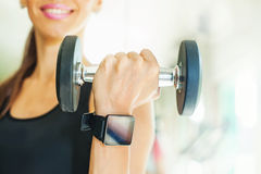 Woman with smart watch. Smart watch showing a heart rate of exercising woman in gym Royalty Free Stock Photography