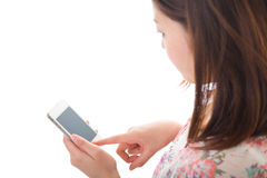 Woman and smartphone. Young woman to see a smartphone Royalty Free Stock Images