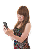 Woman and smartphone. Young woman to see a smartphone Stock Photos