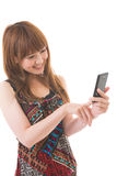 Woman and smartphone. Young woman to see a smartphone Royalty Free Stock Photos