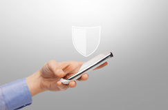 Woman with smartphone and antivirus program icon. Business, people and cyber protection concept - close up of female hand with virtual antivirus program shield Stock Photography