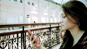 Woman with smartphone Stock Images