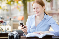 Woman with Smartphone and Book Royalty Free Stock Photos