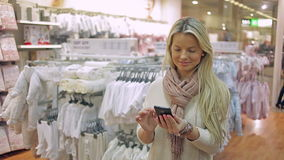 Woman with a smartphone stock video footage
