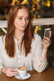 Woman with smartphone and coffee at restaurant. Leisure, technology, lifestyle and people concept - woman with smartphone and coffee at restaurant Stock Images