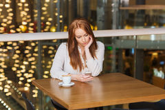 Woman with smartphone and coffee at restaurant. Leisure, technology, lifestyle and people concept - woman with smartphone and coffee at restaurant Stock Photo