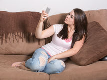Woman smartphone duckface self portrait Stock Photos