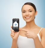 Woman with smartphone and email icon Royalty Free Stock Images