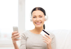 Woman with smartphone and headphones at home Royalty Free Stock Photography