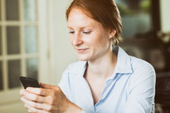 Woman with Smartphone at Home Stock Image