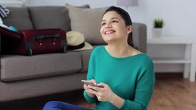 Woman with smartphone at home going to travel stock video