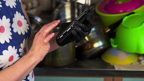 Woman with smartphone in the kitchen stock video footage