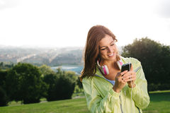 Woman with smartphone messaging during sport exercising Stock Photos