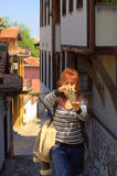 Woman with smartphone in old town Stock Images