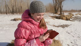 Woman with a smartphone outdoors stock video footage