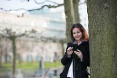 Woman with smartphone in park Stock Photography