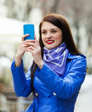 Woman with smartphone photographing Stock Image