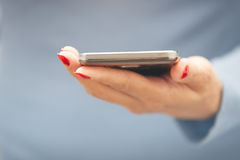Woman with smartphone Stock Photography