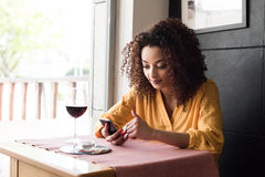 Woman with smartphone in restaurant Royalty Free Stock Photo
