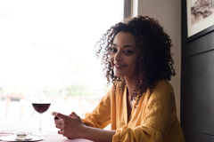 Woman with smartphone in restaurant Royalty Free Stock Images