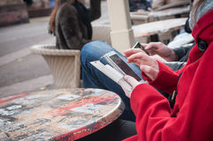 Woman with smartphone at the restaurant terrace Royalty Free Stock Photography