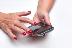 Woman with a smartphone Royalty Free Stock Photography