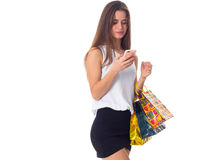 Woman with smartphone and shopping bags Royalty Free Stock Image