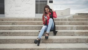 Woman with smartphone sitting on stairs in the city. Young woman with smartphone sitting on stairs in the city stock video