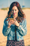 Woman with smartphone in soft pastel colors Stock Photos