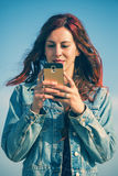 Woman with smartphone in soft pastel colors Stock Photography