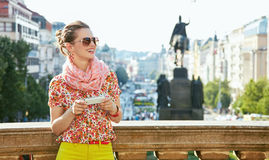 Woman with smartphone standing near National Museum in Prague Stock Photography