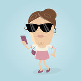 Woman with smartphone and sunglasses Stock Image