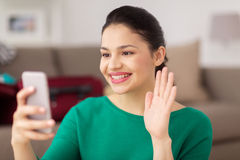Woman with smartphone taking selfie or video call Stock Photo